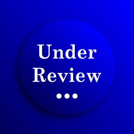 reviewed: Under review icon. Internet button on blue background. Stock Photo