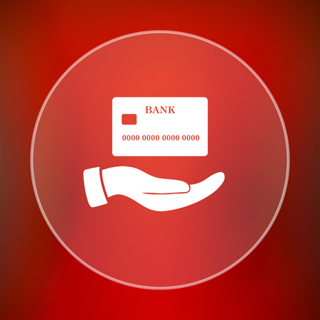 holding credit card: Hand holding credit card icon. Internet button on red background.