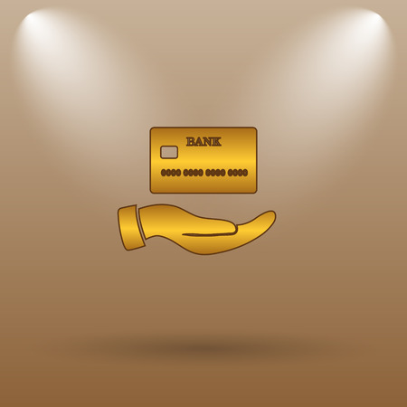 holding credit card: Hand holding credit card icon. Internet button on brown background.