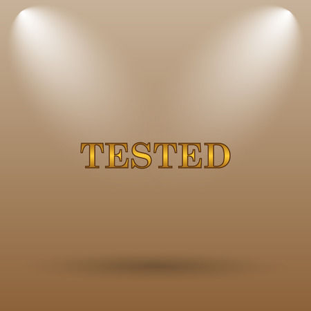 tested: Tested icon. Internet button on brown background. Stock Photo