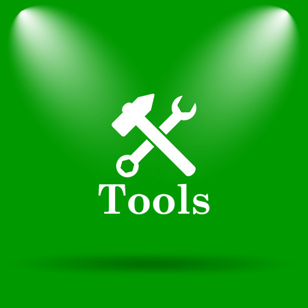 tools icon: Tools icon. Internet button on green background. Stock Photo