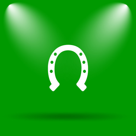 superstition: Horseshoe icon. Internet button on green background.
