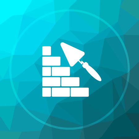 Building wall icon. Building wall website button on blue low poly background.
