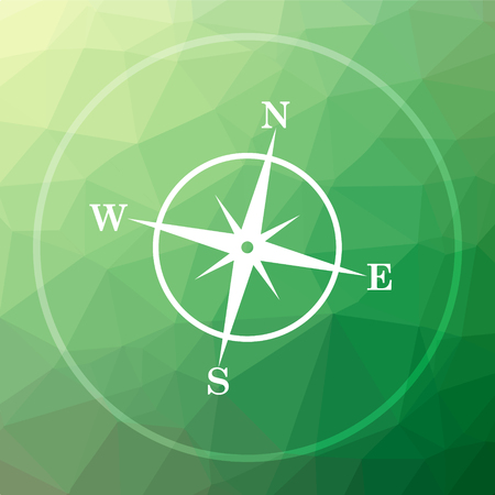 geodesy: Compass icon. Compass website button on green low poly background. Stock Photo