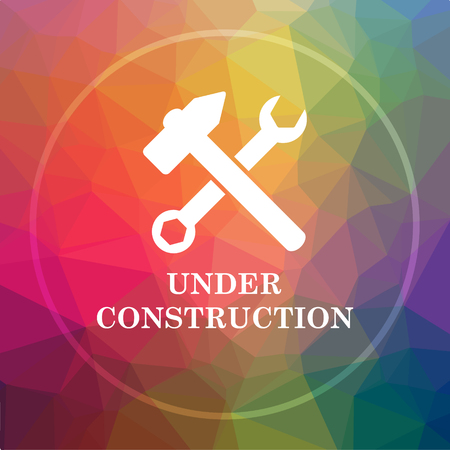 Under construction icon. Under construction website button on low poly background. Stock Photo
