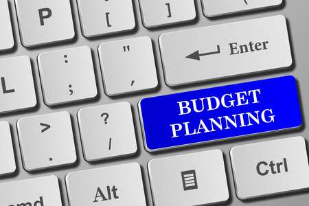 Budget Planning button on modern keyboard. Close-up view on conceptual keyboard.