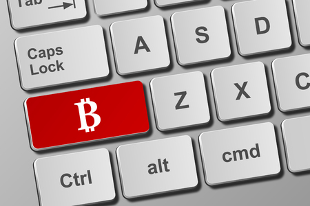 Close-up view on conceptual keyboard with bitcoin button