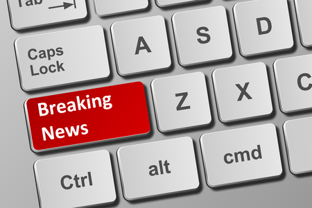 Close-up view on conceptual keyboard with breaking news button