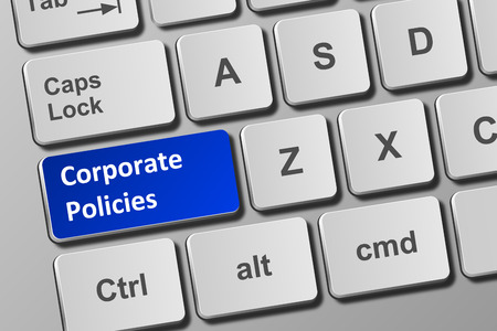 Close-up view on conceptual keyboard with corporate policies button Фото со стока