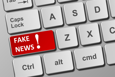 Close-up view on conceptual keyboard with fake news button Фото со стока
