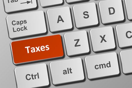 Close-up view on conceptual keyboard with taxes button