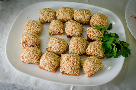 Sandwiches sprinkled with sesame seeds on a white plate 版權商用圖片