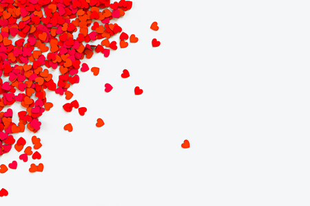 Red hearts confetti. Scatter cornered border on white background. 3D rendering illustration Stock Photo