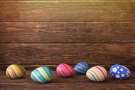 Different easter eggs on wooden background. 3D rendering illustration. Stock Photo