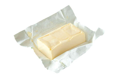 Isolated butter bar on the opened wrapping  Stock Photo