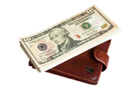 Brown wallet with a bunch of USA dollars on it