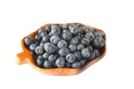 Fresh blueberries in the wooden dish