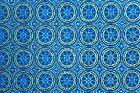 Blue patterned linen background with fine fibers