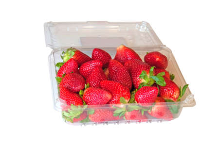Fresh strawberries in the plastic container isolated