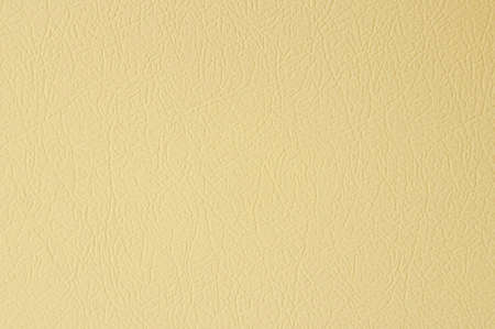 The beige knurled metal background