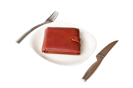 Isolated leather wallet on the white plate with fork and knife