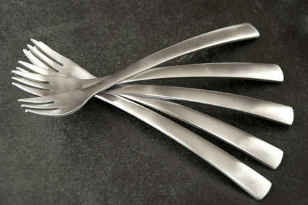 Group of gray metal forks