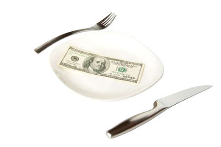 Isolated banknote on the white plate with fork and knife  Stock Photo