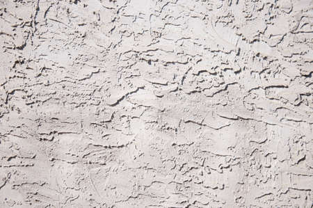 stucco: Gray concrete wall finished with stucco Stock Photo