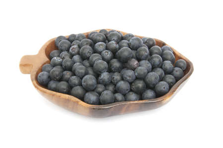 Fresh blueberries in the wooden dish Stock Photo - 9431217
