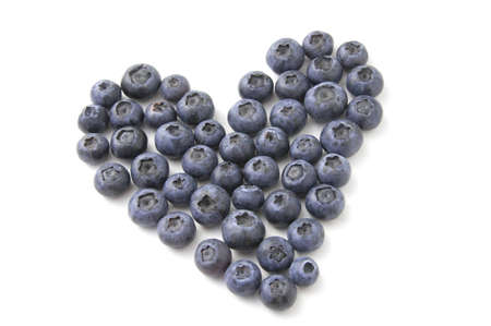 Isolated heart made of  Blueberries