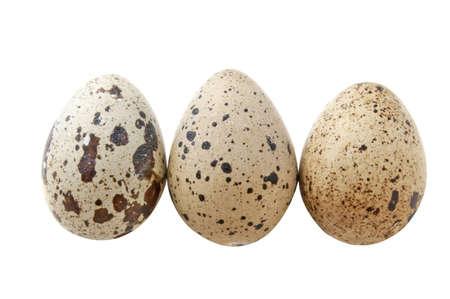 Three quail eggs on the white background