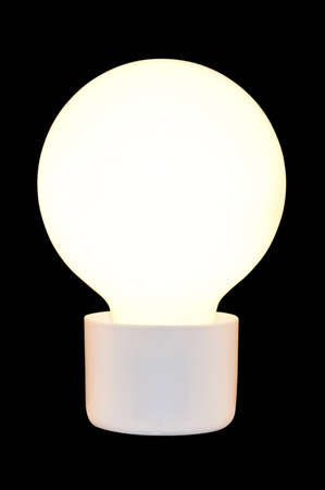 The incandescent lamp on the black background