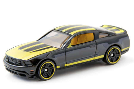 Black and yellow toy car, isolated Stock Photo