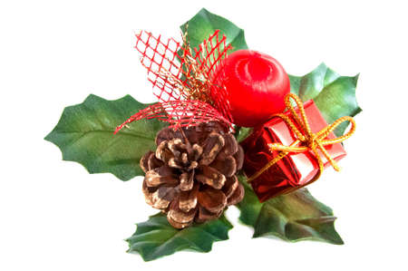 Christmas decoration with a pine-cone and green leaves isolated Stock Photo - 16388144