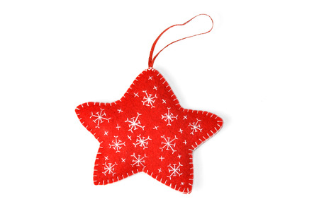 A red star Christmas ornament, isolated