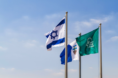 Flags of Israel in the wind 에디토리얼