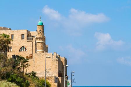 View of the Al-Bahr Mosque or Sea Mosque, minaret of the mosque in Old Jaffa, ancient port of Jaffa, Mediterranean Sea coast in Tel Aviv Yaffo, Israel