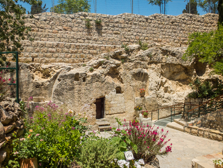 The Garden Tomb, entrance to the tomb cut into the rock. The Garden Tomb, site of pilgrimage, rock tomb outside the walls of the Old City of Jerusalem, Israel Stock Photo