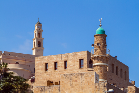 View of the St. Peters Church, bell tower of the Saint Peter Church and the al-Bahr Mosque or Sea Mosque in Old Jaffa in Tel Aviv Yaffo, Israel