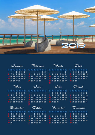 Yearly wall calendar, 2019 year of the year with a single page calendar, A3 size. Beach umbrellas at the promenade in Tel Aviv, Israel