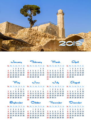Yearly wall calendar, 2019 year of the year with a single page calendar, A3 size. Tomb of prophet Samuel and Nabi Samwil mosque near Jerusalem in Israel 스톡 콘텐츠