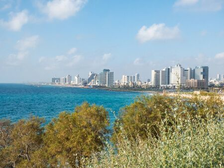 View of the waterfront of Tel Aviv in sunset light, beach coast of Mediterranean sea from the port of Old Jaffa in Israel