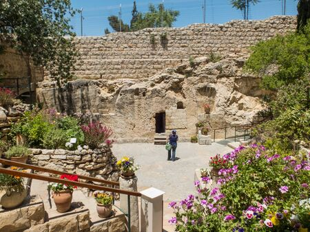 JERUSALEM, ISRAEL - MAY 12, 2017: The Garden Tomb, entrance to the tomb cut into the rock. The Garden Tomb, site of pilgrimage, rock tomb outside the walls of the Old City of Jerusalem, Israel