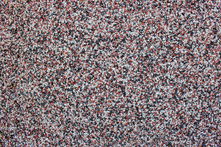 granular: granular surface background with small colored stones