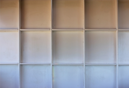 Empty white wooden shelf at the wall with copy space  Stock Photo - 21934947