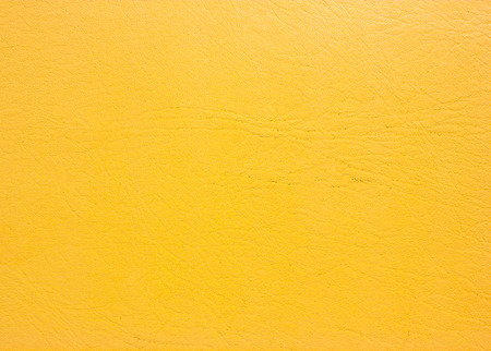 Yellow leather background. Old leather texture. photo