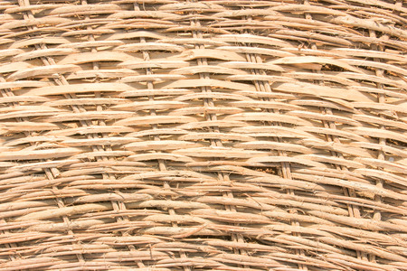 willow fruit basket: Brown wooden background at sun light. Wooden texture.
