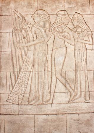 friso: Murales antiguos. Friso de Diosa egipcia. Talla de la pared.
