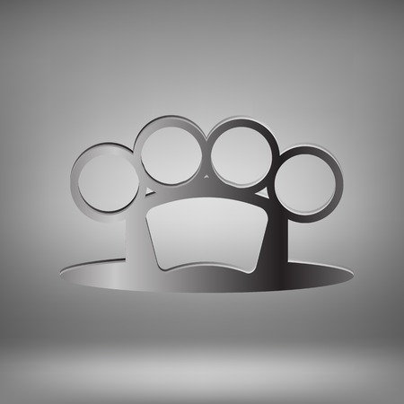 knuckle: Metal Brass Knuckle on Grey Light Background