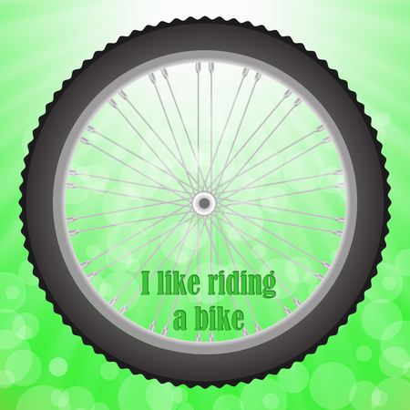 velocipede: Bicycle Wheel Isolated on Summer Green Blurred Background